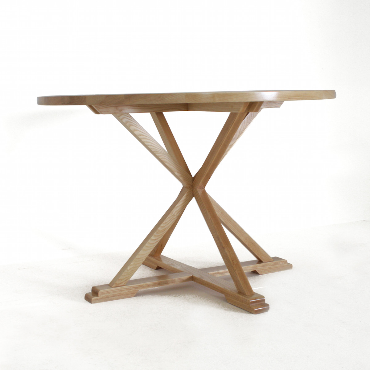 The goodwood co round x leg dining room table the for Dining room tables legs